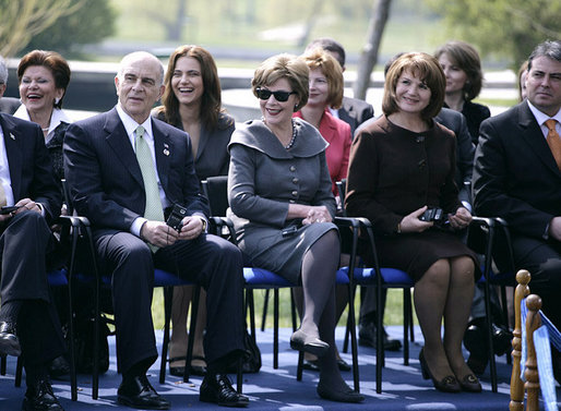 Mrs. Laura Bush and Mrs. Maria Basescu, spouse of Romania's President Traian Basescu, break out in laughter at remarks made Wednesday, April 2, 2008, during a joint press availability with their husbands at the Protocol Villas Neptun-Olimp in Neptun, Romania. White House photo by Shealah Craighead