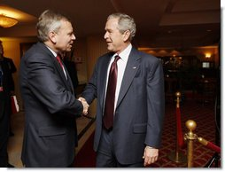 President George W. Bush greets NATO Secretary General Jaap de Hoop Scheffer Wednesday, April 2, 2008, at the JW Marriott Bucharest Grand Hotel in Bucharest, site of the 2008 NATO Summit. White House photo by Eric Draper