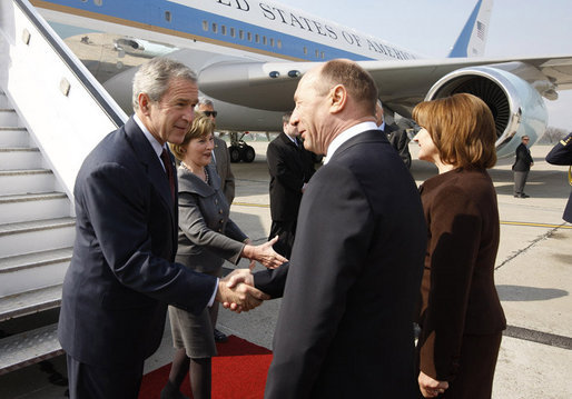 President George W. Bush and Mrs. Laura Bush are greeted upon arrival Wednesday, April 2, 2008, by President Traian Basescu of Romania and Mrs. Maria Basescu at Mihail Kogalniceanu Airport in Constanta, Romania. White House photo by Eric Draper