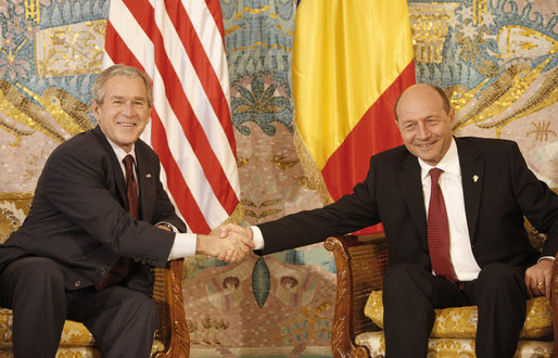 President George W. Bush and President Traian Basescu of Romania, exchange handshakes during their meeting Wednesday, April 2, 2008, in Neptun, Romania. White House photo by Eric Draper