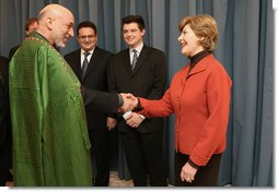 Mrs. Laura Bush greets Afghanistan President Hamid Karzai at the Headquarters of the Romanian Intelligence Service Thursday, April 3, 2008, where they participated in the Young Atlanticist Summit Video Conference with Kabul University.  White House photo by Shealah Craighead