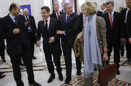 President George W. Bush embraces President Nicolas Sarkozy of France, as they arrive for a session of the NATO Summit Thursday, April 3, 2008, in Bucharest. White House photo by Eric Draper