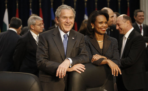 President George W. Bush stands with Secretary of State Condoleezza Rice Thursday, April 3, 2008, during the North Atlantic Council Summit in Bucharest. White House photo by Eric Draper
