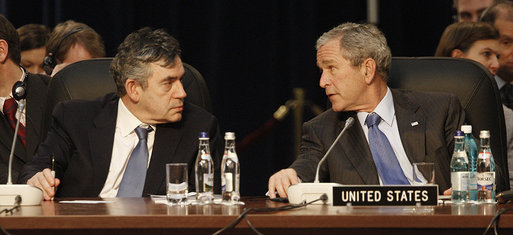 President George W. Bush and Prime Minister Gordon Brown of the United Kingdom, speak together at the start of the day's session Thursday, April 3, 2008, at the 2008 NATO Summit in Bucharest. White House photo by Eric Draper