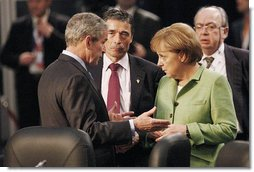 President George W. Bush joins Danish Prime Minister Anders Fogh Ransmussen and German Chancellor Angela Merkel Thursday, April 3, 2008, prior to the start of the afternoon's NATO Summit Meeting on Afghanistan in Bucharest. White House photo by Eric Draper