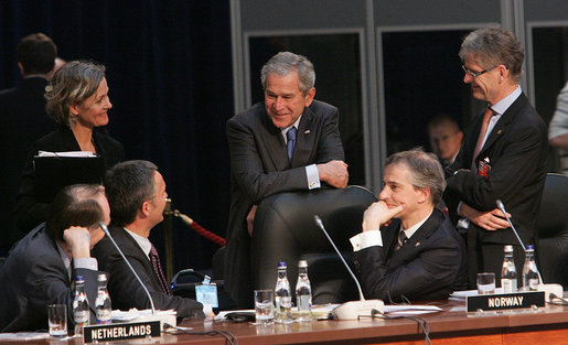 President George W. Bush shares a light moment with Norway's Prime Minister Jens Stoltenberg, left, and Foreign Minister Jonas Gahr Store, right, during the NATO Summit Thursday, April 3, 2008, in Bucharest. White House photo by Chris Greenberg