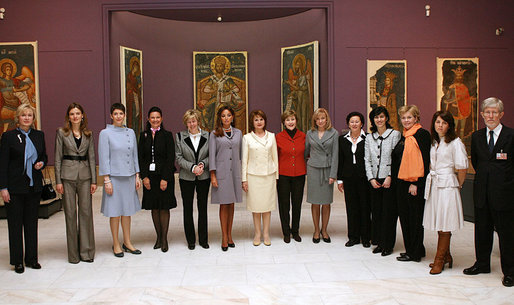 Mrs. Laura Bush poses for a photo with other NATO Spouses' during a visit to the National Art Museum Thursday, March 3, 2008, in Bucharest. White House photo by Shealah Craighead