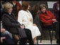 Mrs. Laura Bush leans in to listen to Alexandra Coman, fiance of Romania's Foreign Minister Adrian Cioroianu, as they join other guests, including Mrs. Maria Basescu, in white, spouse of Romania's President Taian Basescu, and Mrs. Jeannie de Hoop Scheffer, spouse of NATO Secretary General Jaap de Hoop Scheffer, at the Dimitrie Gusti Village museum in Bucharest. White House photo by Shealah Craighead