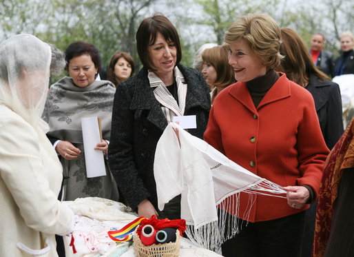 Mrs. Laura Bush spends a moment with a traditional handicraft artisan at Dimitrie Gusti Village during an outing Thursday, April 3, 2008, with NATO spouses to the Bucharest open-air museum. White House photo by Shealah Craighead