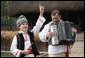A young boy sings and dances as he's accompanied by an accordionist during a performance for the official NATO Spouses' Program Thursday, April 3, 2008, at the Dimitrie Gusti Village Museum in Bucharest. White House photo by Shealah Craighead
