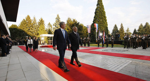 President George W. Bush and President Stjepan Mesic of Croatia review troops Friday, April 4, 2008, during welcoming ceremonies in Zagreb for the President and Mrs. Bush. White House photo by Eric Draper
