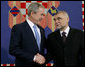 President George W. Bush shakes hands with President Stjepan Mesic of Croatia during arrival ceremonies in honor of the President and Mrs. Bush Friday, April 4, 2008, at the Office of the President in Zagreb. White House photo by Chris Greenberg