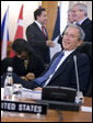 President George W. Bush smiles at photographers as they gather in front of him Friday, April 4, 2008, during the afternoon session of the 2008 NATO Summit in Bucharest. White House photo by Eric Draper