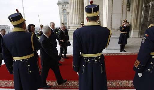 President George W. Bush arrives at the Palace of the Parliament Friday, April 4, 2008, for the second day of meetings at the 2008 NATO Summit in Bucharest. With him are Secretary of State Condoleezza Rice, Secretary of Defense Robert Gates and National Security Advisor Stephen Hadley. White House photo by Eric Draper