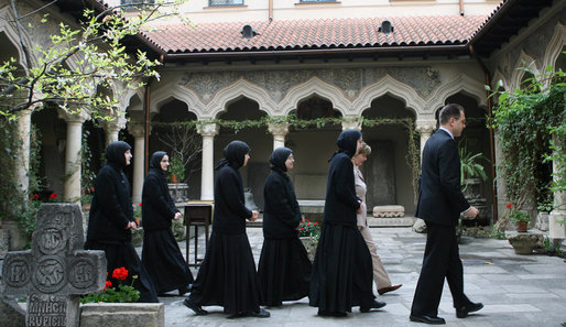 "Mrs. Laura Bush and Sisters of the Stavropoleos Monastery in Bucharest, follow Dr. Petre Radu Guran as he leads them across the church courtyard Friday, April 4, 2008. In 2003, the U.S. Embassy donated $27,000 for the restoration of the courtyard under the auspices of a special U.S. Department of State program entitled, ""Ambassador's Fund for Cultural Preservation. White House photo by Shealah Craighead"