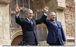 President George W. Bush and Prime Minister Ivo Sanader of Croatia, raise hands together before thousands who flocked to St. Mark's Square in downtown Zagreb Saturday, April 5, 2008, to see and hear the U.S. President.  White House photo by Eric Draper