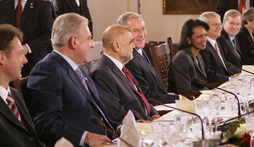 President George W. Bush smiles as he participates in a working lunch with future NATO leaders Saturday, April 5, 2008, in Zagreb. Next to him is President Stjepan Mesic of Croatia. White House photo by Chris Greenberg