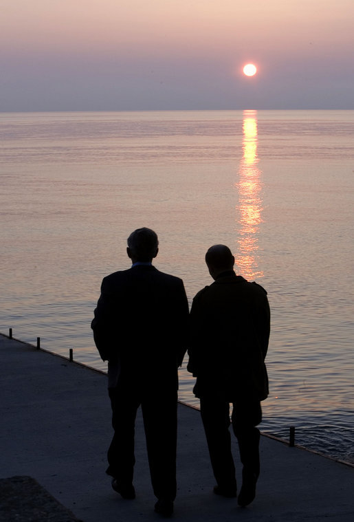 President George W. Bush and Russia's President Vladimir Putin take a sunset walk on a pier along the Black Sea during a visit by President and Mrs. Bush Saturday, April 5, 2008, to President Putin's summer retreat, Bocharov Ruchey, in Sochi, Russia. White House photo by Eric Draper