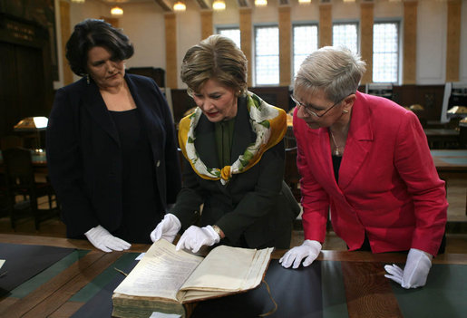 Mrs. Laura Bush is shown a rare book during her visit Saturday, April 5, 2008, to the Croatian State Archives in Zagreb. White House photo by Shealah Craighead