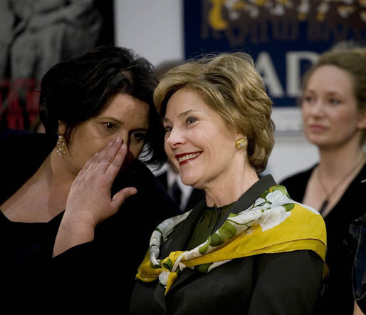 Mrs. Laura Bush watches the Lado National Folk Dance Ensemble performance, Saturday, April 5, 2008 in Zagreb, as the wife of Prime Minister Sanader translates the performance lyrics for her. White House photo by Shealah Craighead