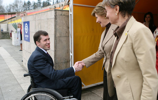 Mrs. Laura Bush is welcomed by Mr. Mikhail Terentyev, Secretary General of the Russian Paralympic Committee, to Central Sochi Stadium in Sochi Sunday, April 6, 2008. Mrs. Bush visited with the team before departing Sochi for Washington, D.C. White House photo by Shealah Craighead