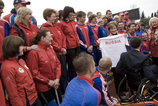 Mrs. Laura Bush holds a T-shirt presented to her Sunday, April 6, 2008, by members of the Russian Paralympic team at Central Sochi Stadium in Sochi, Russia. White House photo by Shealah Craighead