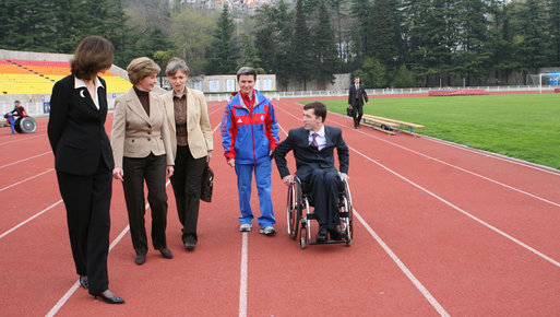 Mrs. Laura Bush walks on the track of Central Sochi Stadium Sunday, April 6, 2008, with Mr. Mikhail Terentyev, Secretary General of the Russian Paralympic Committee, Ms. Lisa Carty, spouse of the U.S. Ambassador to Russia William Burns, and Mrs. Irina Gromova, Coach of the Russian Paralympic team. White House photo by Shealah Craighead