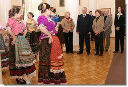 "Mrs. Laura Bush stands with Sochi Mayor Viktor Kolodyazhny as they listen to the Russian singing group ""Lubo,"" during a visit Sunday, April 6, 2008, to the Sochi Art Museum. With them at left is Mrs. Svetlana Ushakova, spouse of Yury Ushakov, Russian Ambassador to the United States. White House photo by Shealah Craighead"