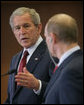 President George W. Bush looks toward President Vladimir Putin Sunday, April 6, 2008, while making remarks during a joint press availability at the State Resident of the President of Russia in Sochi. White House photo by Chris Greenberg