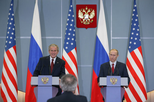 President George W. Bush and President Vladimir Putin smile as they respond to a reporter's question Sunday, April 6, 2008, during a joint press availability in Sochi, Russia. White House photo by Chris Greenberg