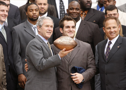 Louisiana State University Tigers' running back Jacob Hester stands next to President George W. Bush after presenting him with a football during a visit to the White House Monday, April 7, 2008, by the 2007 NCAA Football Champions. White House photo by Eric Draper