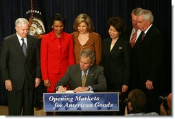 President George W. Bush signs transmittal papers for the Colombian Free Trade Agreement Monday, April 7, 2008, in Dwight D. Eisenhower Executive Office Building. President Bush is joined by, left to right, Secretary Bob Gates, Department of Defense; Secretary Condoleezza Rice, Department of State; Ambassador Susan Schwab, United States Trade Representative; Secretary Elaine Chao, Department of Labor; Director John Walters, Office of National Drug Control Policy; and Secretary Ed Schafer, Department of Agriculture. White House photo by Joyce N. Boghosian