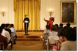 Mrs. Laura Bush welcomes Salma Kikwete, First Lady of Tanzania, during her remarks before a performance from Ford Theatre's new production, One Destiny, Monday, April 7, 2008, in the East Room of the White House.  White House photo by Shealah Craighead