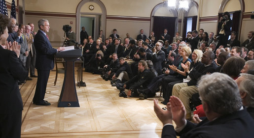"President George W. Bush and members of the audience acknowledge Thomas Boyd, at right in dark shirt, after the President mentioned him in remarks Wednesday, April 9, 2008, during the signing of H.R. 1593, the Second Chance Act of 2007. The Second Chance Act aims to reduce prison populations and corrections costs by reducing the recidivism rate by providing federal funding to develop programs dealing with job training, substance abuse, and family stability. In acknowledging Mr. Boyd, a 53-year-old graduate of the Jericho re-entry program in Baltimore, the President said, ""I want to thank you for coming, Thomas. There's a lot of other Thomases out there that we're going to help with this bill."" White House photo by Eric Draper"