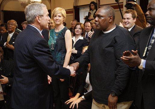 "President George W. Bush reaches out to Thomas Boyd Wednesday, April 9, 2008, after signing HR 1593, the Second Chance Act of 2007. Mr. Boyd spent more than 20 years in and out of the prison system until he took his daughter's advice and enrolled in the Jericho program in Baltimore. His success in the re-entry program was noted during the President's remarks when he said, ""He's working, back with his family; he's a good guy. And I want to thank you for coming, Thomas."" White House photo by Eric Draper"