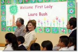 Mrs. Laura Bush sits before a banner welcoming her to the Williams Preparatory School in Dallas, Thursday, April 10, 2008, where she participated in the First Bloom program activities to help encourage youth to get involved with conserving America's National Parks. The First Bloom program is being introduced in five cities across the nation to give children a sense of pride in our natural resources and to be good stewarts of America's diverse environment. White House photo by Shealah Craighead