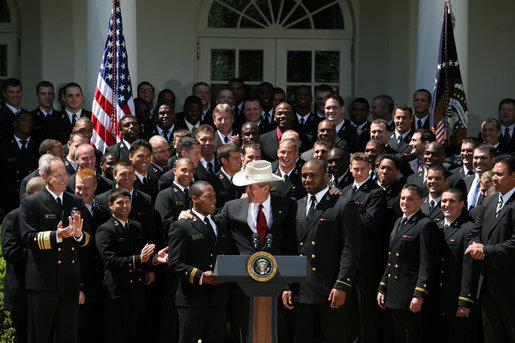 President George W. Bush joins the United States Naval Academy Football Team Monday, April 14, 2008, following the presentation of the Commander-in-Chief's Trophy to the The Naval Academy Midshipmen in the Rose Garden of the White House. White House photo by Joyce N. Boghosian