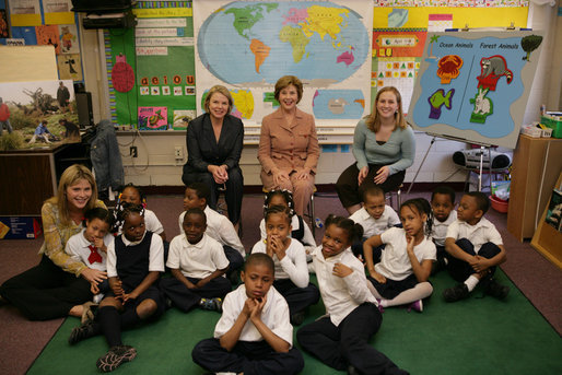 Mrs. Laura Bush, her daughter Jenna Bush, left, and U.S. Education Secretary Margaret Spellings pose for a photo with the first grade students of teacher Laura Gilbertson, right, Monday, April 14, 2008, at the Martin Luther King Elementary School in Washington, D.C., to mark the tenth anniversary of Teach for America Week. White House photo by Shealah Craighead