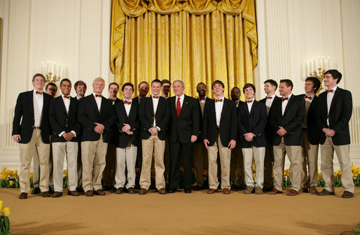 President George W. Bush thanks the Virginia Gentlemen, an a cappella vocal ensemble of the University of Virginia, following their performance Monday evening, April 14, 2008 in the East Room of the White House, during a reception in honor of the 265th birthday of former President Thomas Jefferson. White House photo by Chris Greenberg