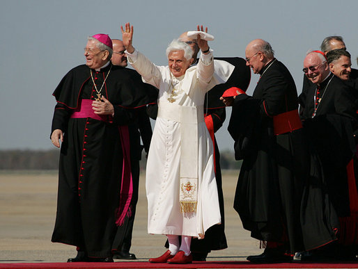 Pope Benedict XVI acknowledges the cheers of the crowd on his arrival to Andrews Air Force Base, Md., Tuesday, April 15, 2008, where he was greeted by President George W. Bush, Laura Bush and their daughter, Jenna. White House photo by Shealah Craighead