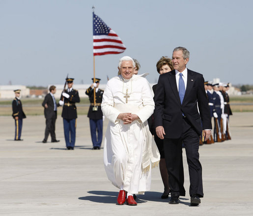 President George W. Bush, Mrs. Laura Bush and daughter, Jenna Bush, walk with Pope Benedict XVI after the Pontiff's arrival Tuesday, April 15, 2008, at Andrews Air Force Base, Maryland. White House photo by Eric Draper