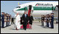 President George W. Bush walks the red carpet with Pope Benedict XVI upon the Pontiff's arrival Tuesday, April 15, 2008, at Andrews Air Force Base, Maryland. Mrs. Laura Bush and daughter Jenna also were on hand to accompany welcome the Pope. White House photo by Chris Greenberg