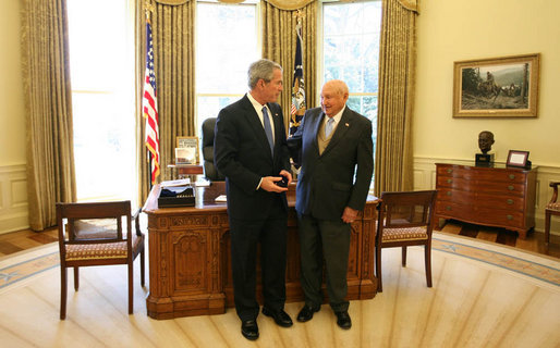 President George W. Bush stands with Truett Cathy, Founder, President and CEO of Chick-fil-A and Founder of the WinShape Foundation, after he presented Mr. Cathy with the Lifetime President's Volunteer Service Award at the White House. White House photo by Joyce N. Boghosian