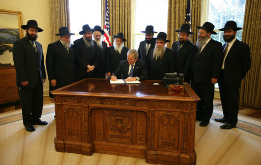 With Chabad rabbis from across the world looking on, President George W. Bush signs a presidential proclamation Tuesday, April 15, 2008, in honor of Wednesday's Education and Sharing Day, and highlighting the important work of the Chabad Lubavitch movement. The Chabad Lubavitch movement promotes global education, and since 1978, every President has signed an Education and Sharing Day proclamation. White House photo by Joyce N. Boghosian