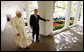President George W. Bush escorts Pope Benedict XVI along the White House Colonnade for their meeting in the Oval Office Wednesday, April 16, 2008, following the Pope's welcoming ceremony on the South Lawn of the White House. White House photo by Eric Draper