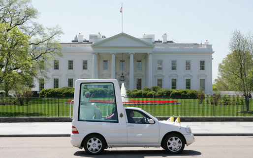 Pope Benedict XVI waves from the Pope-mobile as he passes the White House on Pennsylvania Avenue Wednesday, April 16, 2008, following a welcoming ceremony in his honor on the South Lawn. White House photo by Chris Greenberg