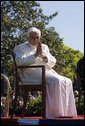 "Pope Benedict XVI acknowledges guests Wednesday, April 16, 2008, during the arrival ceremony for the Pope on the South Lawn of the White House. Said Pope Benedict XVI during the ceremony, ""Mr. President, dear friends, as I begin my visit to the United States, I express once more my gratitude for your invitation, my joy to be in your midst, and my fervent prayers that Almighty God will confirm this nation and its people in the ways of justice, prosperity and peace."" White House photo by David Bohrer"