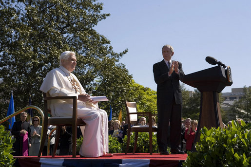 "President George W. Bush applauds Pope Benedict XVI, Wednesday, April 16, 2008, during an arrival ceremony for the Pope on the South Lawn. During his remarks the Pope encouraged the American people saying, ""I am confident that the American people will find in their religious beliefs a precious source of insight and an inspiration to pursue reasoned, responsible and respectful dialogue in the effort to build a more human and free society."" White House photo by David Bohrer"
