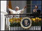 President George W. Bush and Laura Bush applaud as Pope Benedict XVI acknowledges being sung happy birthday by the thousands of guests Wednesday, April 16, 2008, at his welcoming ceremony on the South Lawn of the White House. White House photo by Eric Draper