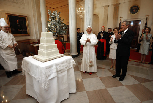 President George W. Bush and Mrs. Laura Bush lead the celebration of the 81st birthday of Pope Benedict XVI as he's presented a cake by White House Pastry Chef Bill Yosses Wednesday, April 16, 2008, at the White House. White House photo by Eric Draper